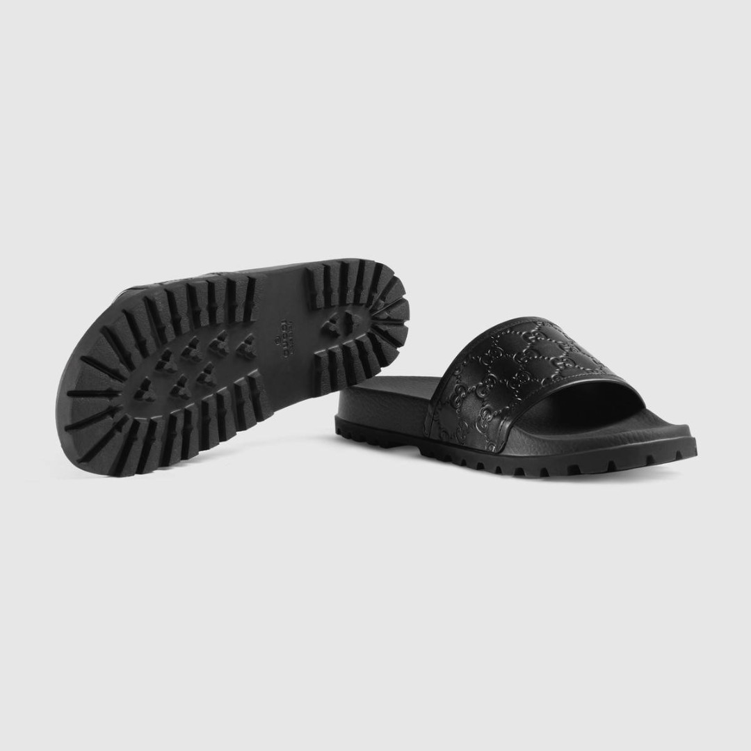 a077213dc3f1 Men s Black Gucci Signature slide sandal