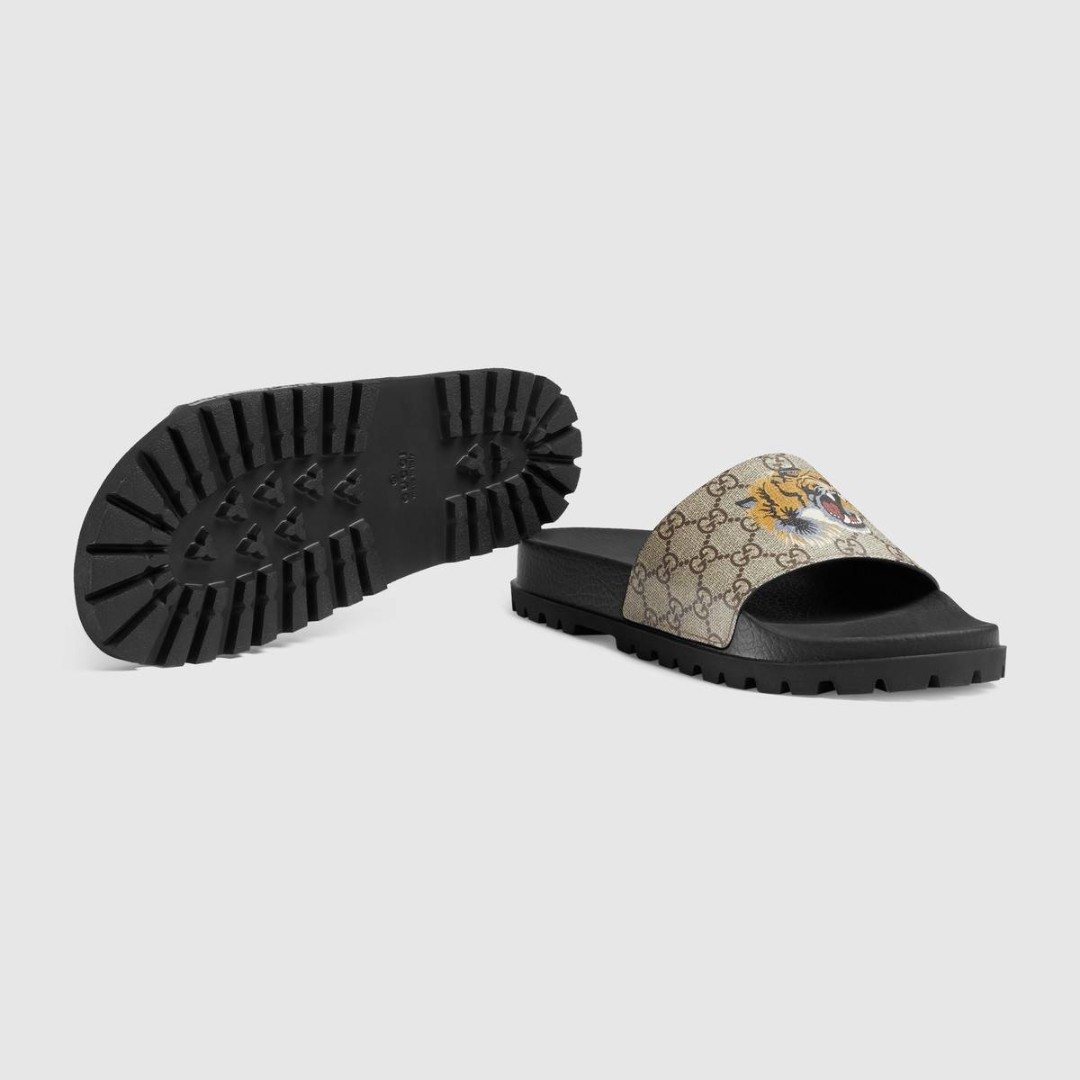401bc7ceaae Men s GG Supreme tiger slide sandal