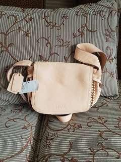 Auth brand new Coach Sling bag beige