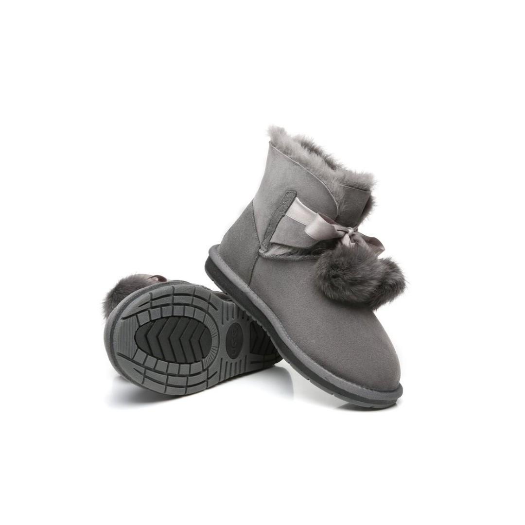 UGG Ladies Mini Boots with Ribbon Pom Pom Gia - Australian Double Face Sheepskin Water Resistant