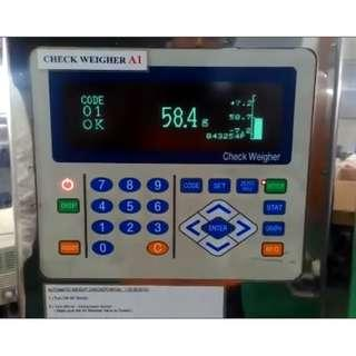 Check Weigher Machine Repairs by Dynamics Circuit (S) Pte. Ltd.