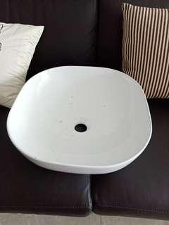 Square toilet basin