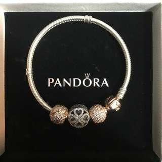 Pandora bracelet with rose gold clasp & charms