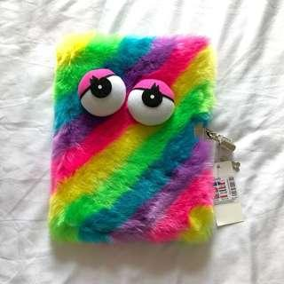 Claire's rainbow monster notebook