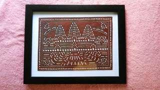 Cambodia art - leather carving in frame (Angkor Wat scenery)