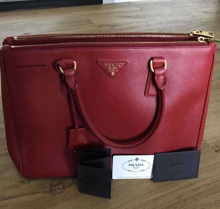 fa1671fd1d Authentic Prada saffiano red handbag
