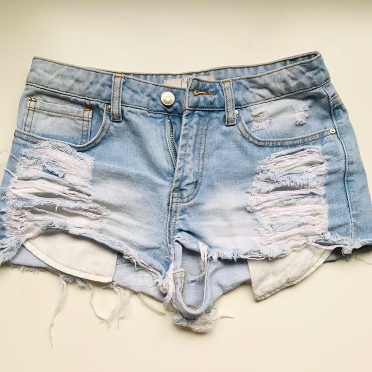 Distressed high-waist denim shorts