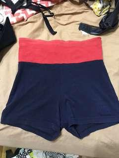Navy blue bike shorts with pink