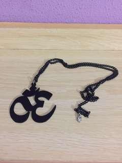 Black acrylic OHM necklace