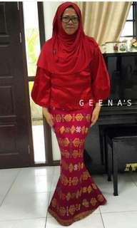 Red blouse top and kain songket