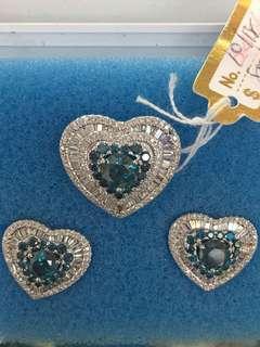 Heart set with blue diamonds