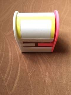 sticky note with dispenser