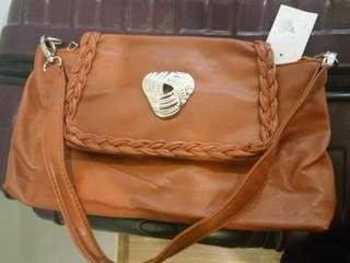 Ladies shoulder bag and pouch