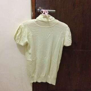 yellow turtle neck shirt