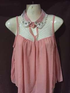 Peach sleeveless blouse