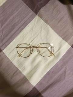 gold framed glasses