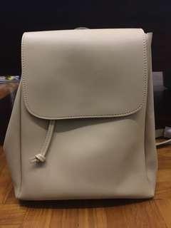 Cream coloured drawstring backpack