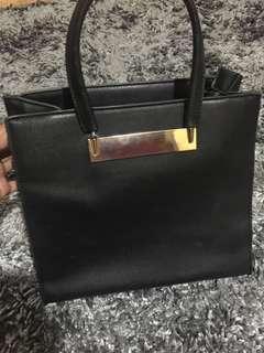 black gold bag