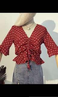 Red poka dot drawstring shirt