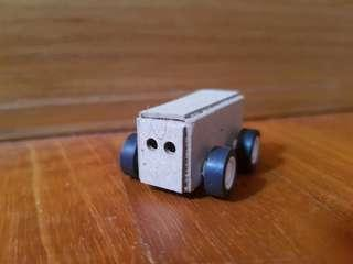 Tiny cardboard car