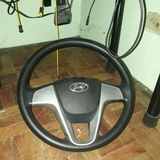 Accent steering wheel and emblem