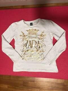 Zara girl long sleeved white blouse with gold words