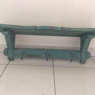 Lovely painted shelf with three hooks