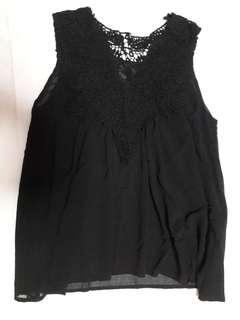 Black sleeveless top.
