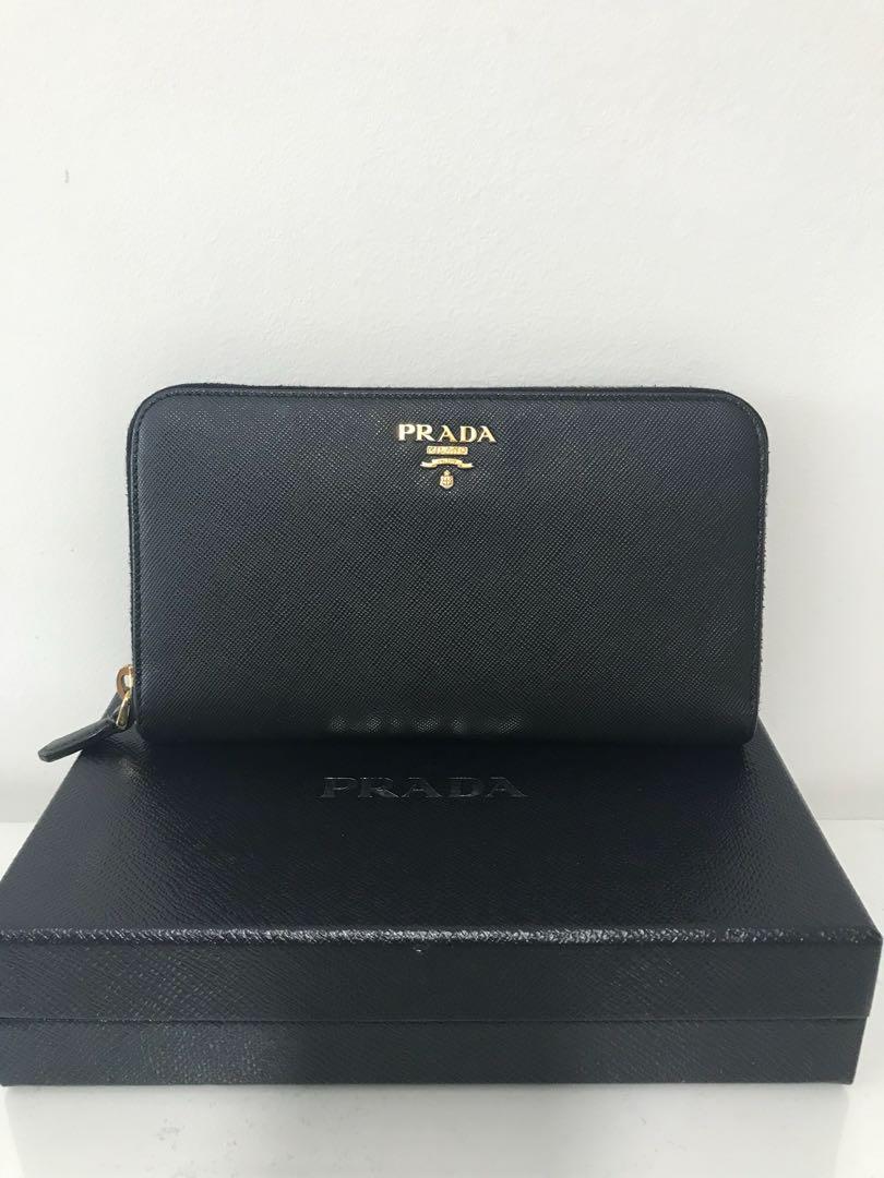 129becd28d1dcd Prada zip around wallet, Luxury, Bags & Wallets, Wallets on Carousell