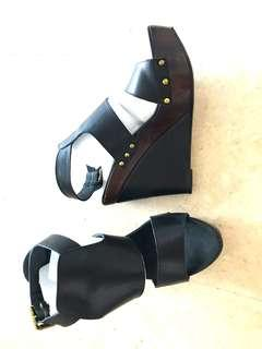 Barely used black leather wedges