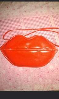 Sling bag lips