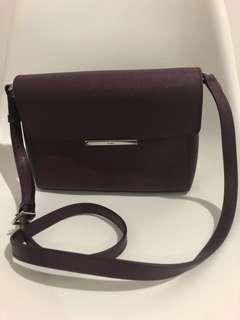 Authentic Tumi Sling bag in purple