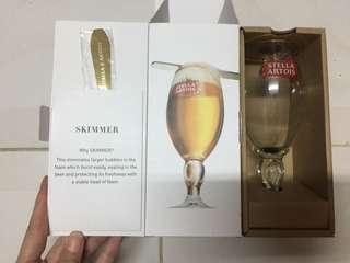 Stella Artois chalice glass and skimmer