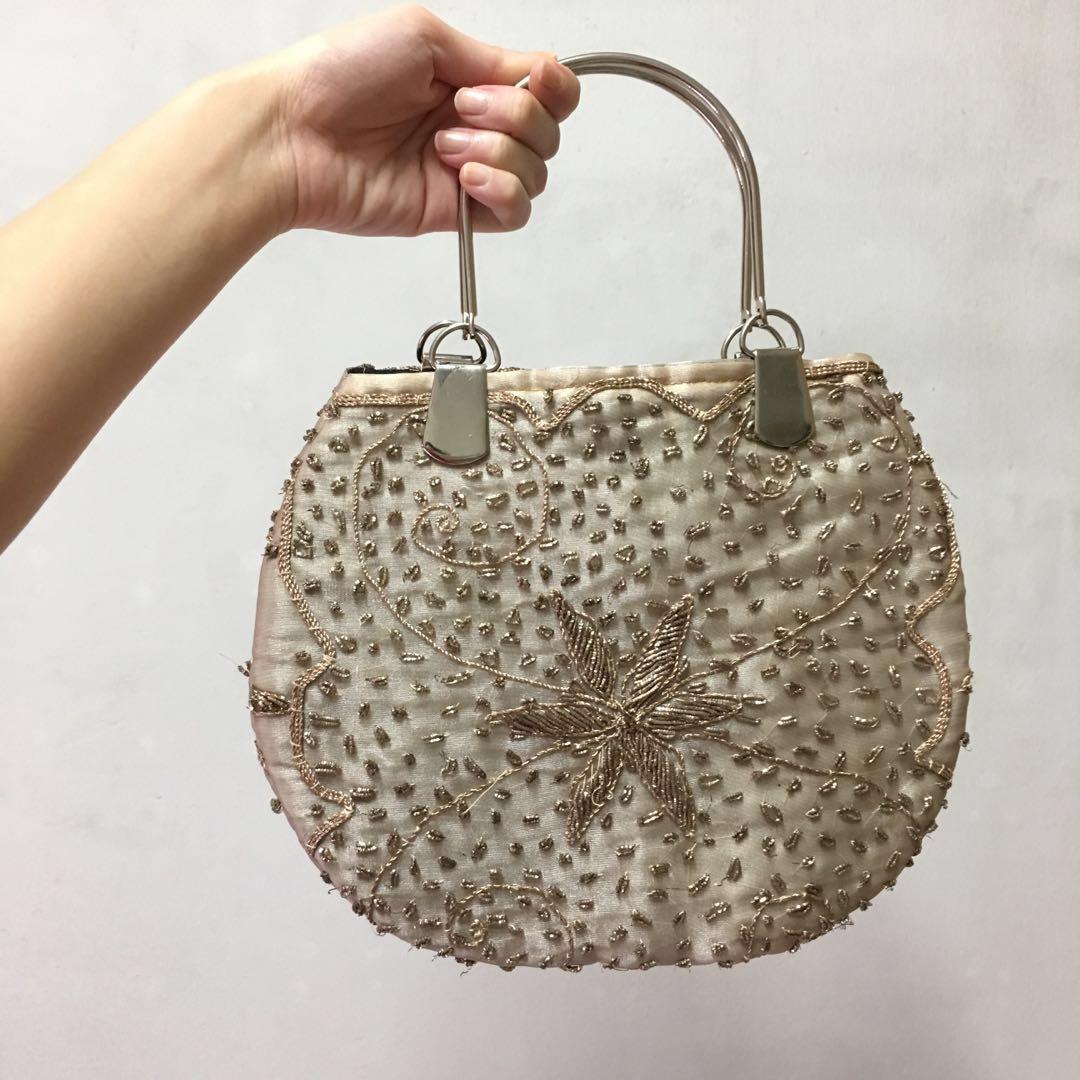 Gold round embroidered handbag