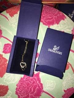 Swarovski two heart necklace.