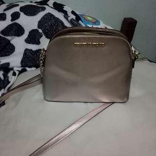 Cipriano metallic sling bag