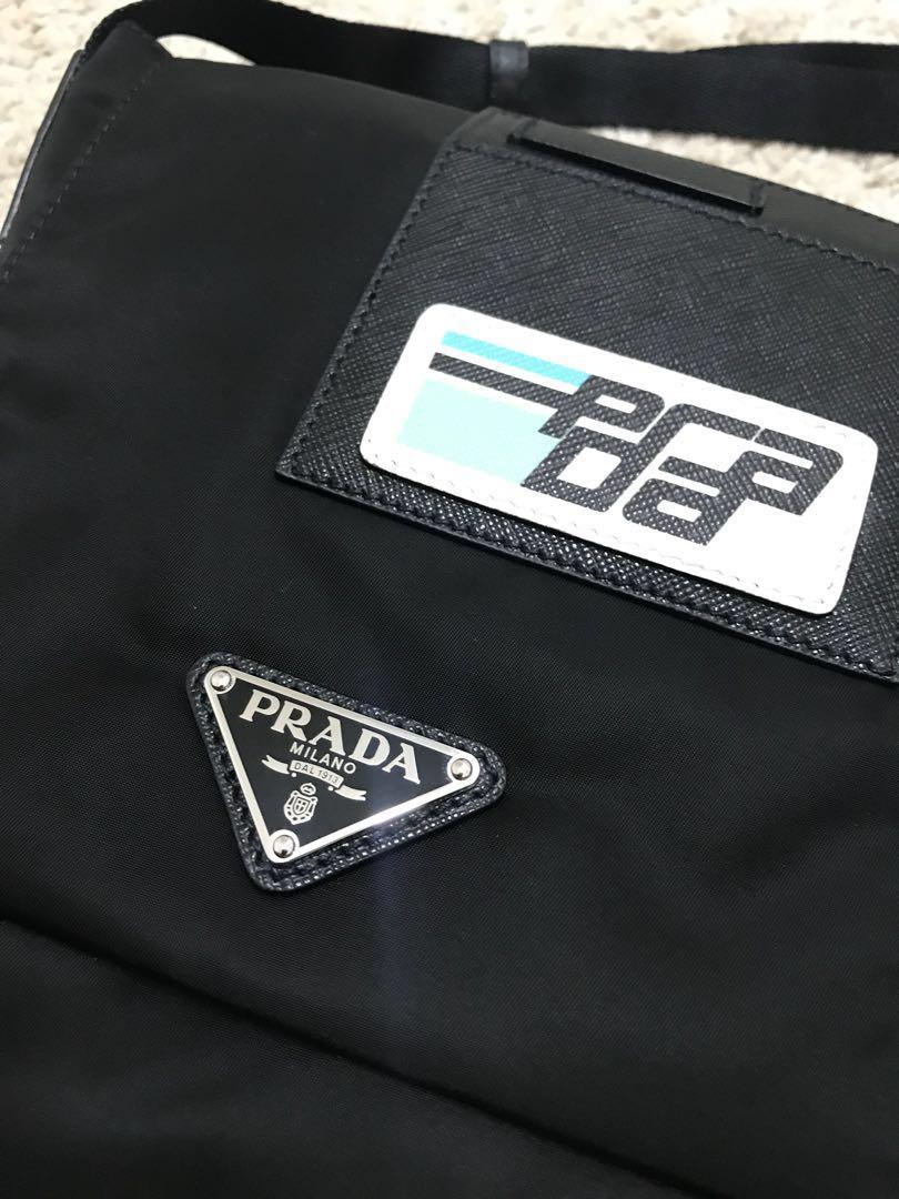 59d8621f7f77 Prada Logo-Plaque Nylon Cross-Body Bag, Men's Fashion, Bags & Wallets,  Sling Bags on Carousell