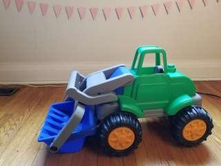 Tractor with shovel. New. comes with 3 settings  Received brand new as gift from grand parents but we re clearing out toys for christmas gifts.  Practically new Pickup Gerrard and Main street in the beaches area for $8 or
