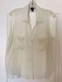 White button-up sleeveless blouse. Size L Large. Ladies/Girls/Teens only worn once! Like new!