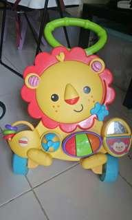 FISHER PRICE MUSICAL BABY WALKER LION