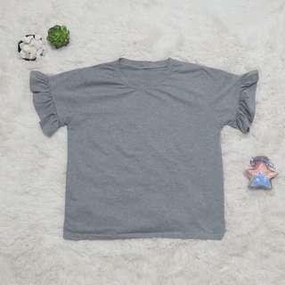 Bell sleeved gray shirt