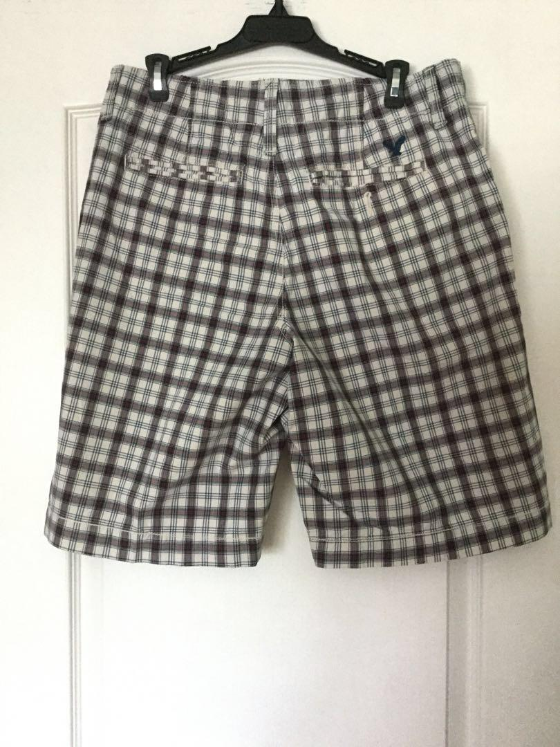 American Eagle Outfitters Navy Blue and white plaid males shirts. Size 30. Men's/Teen Boys EUC