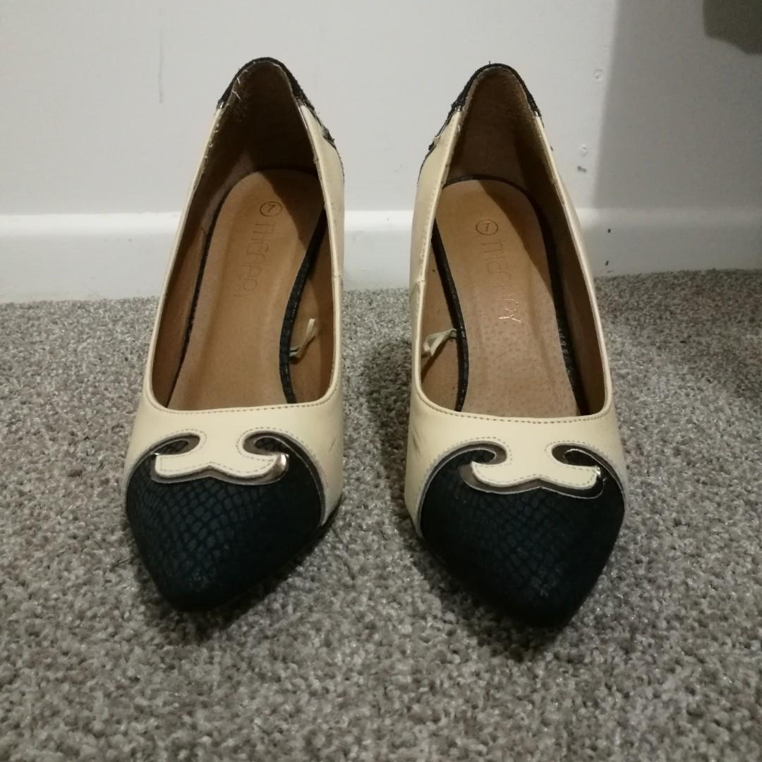 Cream and black heels