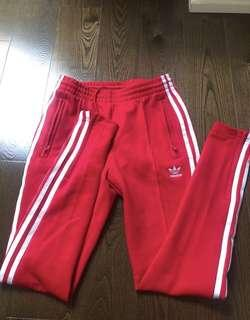 Red adidas pants