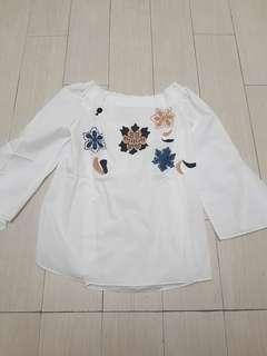 White floral blouse