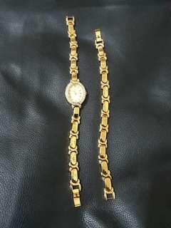 Gold watch and bracelet