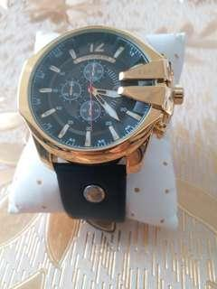 man fashion watch gold black