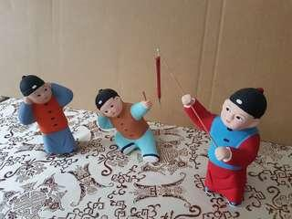 A set of 3 China Mud Toys