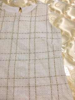 White and gold plaid work top