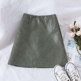Green leather look skirt